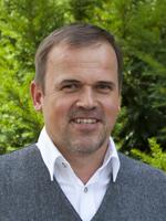 Sie sehen Martin Rihl den Leiter der Bereiche Wohnen und Fördern